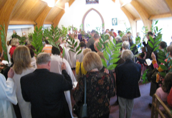 People holding palm branches on Palm Sunday.